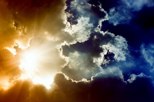 sun-behind-dark-clouds-featured-w740x493